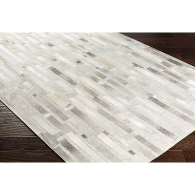 Armando Retangle Hand-Crafted Brown Area Rug Rug Size: Rectangle 5 x 76