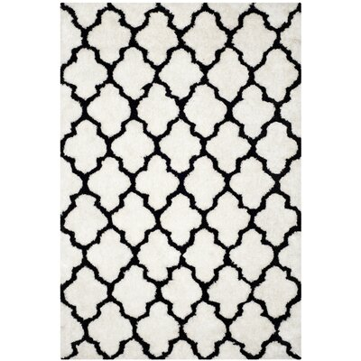 Hand-Tufted Black/Ivory Area Rug Rug Size: 6 x 9