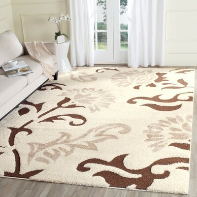Flanery Cream Area Rug Rug Size: 53 x 76