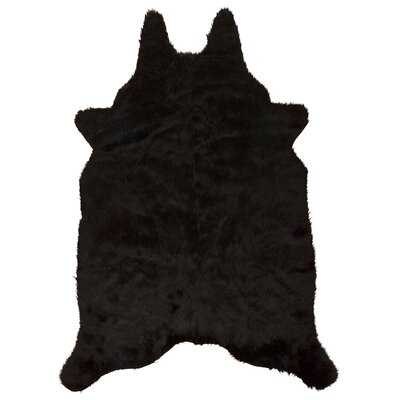 Sonnier�Faux Sheepskin Black Area Rug