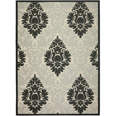 Jarrow Sand/Black Outdoor Area Rug Rug Size: 4' x 5'7