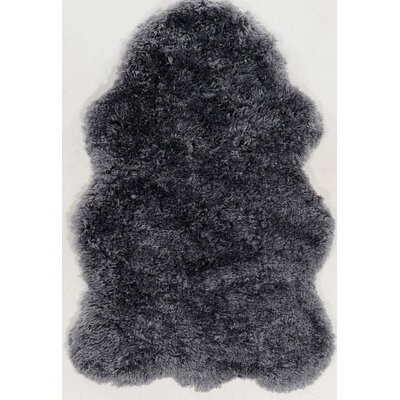 Peridot Faux Lamb Skin Hand-Tufted Black Area Rug