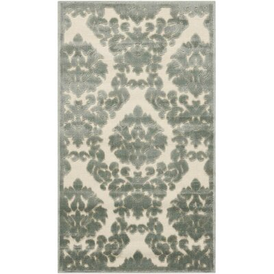 Hartz Ivory/Green Area Rug Rug Size: Rectangle 22 x 39