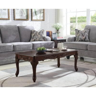 Longoria Traditional Ornate Detailing Wood Coffee Table Color: Dark Cherry