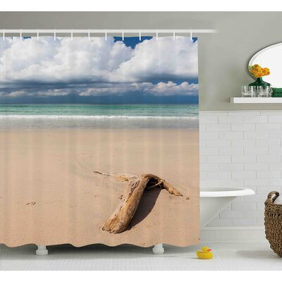 Gracie Driftwood a Driftwood on The Beach and Cloudy Sky Coming Storm Digital Image Shower Curtain Size: 69 W x 70 H
