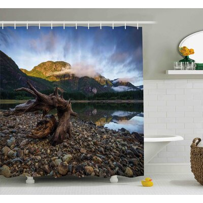 Brynie Landscape of a Mountain Lake and Cloudy Sky Driftwood on Rocky Shore Shower Curtain Size: 69 W x 70 H