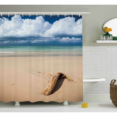 Deana Sea Theme Driftwood on The Sandy Beach and Cloudy Sky Digital Print Shower Curtain Size: 69 W x 75 H