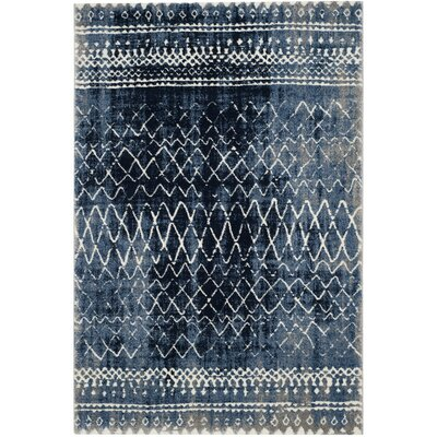 Loganne Blue Area Rug Rug Size: 67 x 92