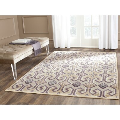 Saint-Michel Gold/Beige Area Rug Rug Size: Rectangle 76 x 106