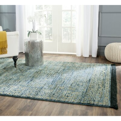 Zennia Turquoise & Gold Area Rug Rug Size: Rectangle 8 x 10