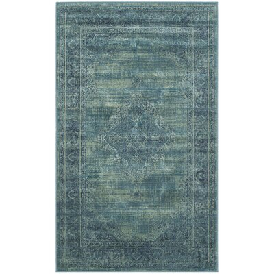 Vishnu Turquoise Area Rug Rug Size: 33 x 57