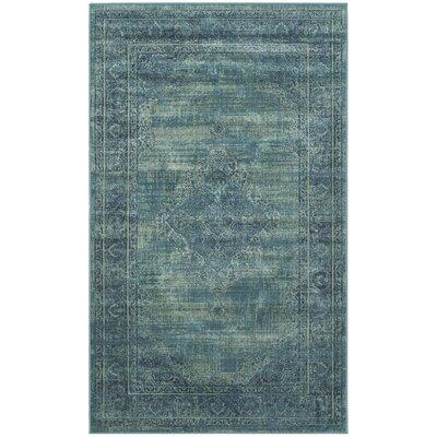 Vishnu Turquoise Area Rug Rug Size: 10 x 14