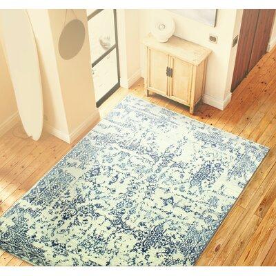Arlingham Ivory/Navy Blue Area Rug Rug Size: 5 x 76