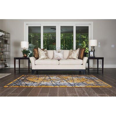 Yareli Black/Orange Area Rug Rug Size: 5 x 8