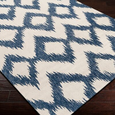 Jayceon Blue/Cream Ikat Area Rug Rug Size: 36 x 56
