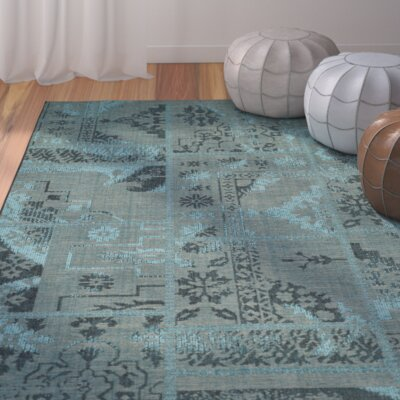 Port Laguerre Black/Turquoise Velvety Area Rug Rug Size: Rectangle 8 x 11