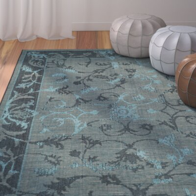 Mahmoud Black and Turquoise Area Rug Rug Size: 5 x 8