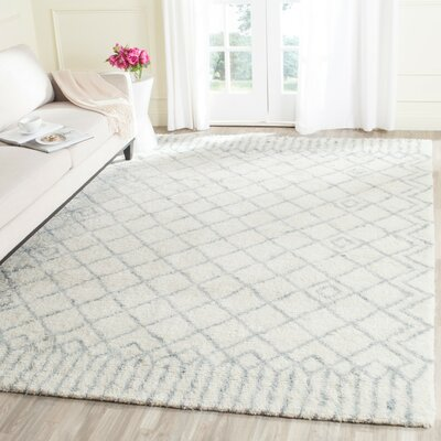 Farrar Hand-Tufted Ivory/Blue Area Rug