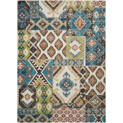 Star Green/Blue/Orange Area Rug Rug Size: 7'10