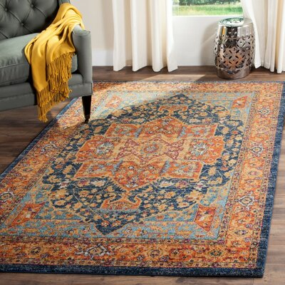 Battista Blue/Orange Area Rug Rug Size: Round 67