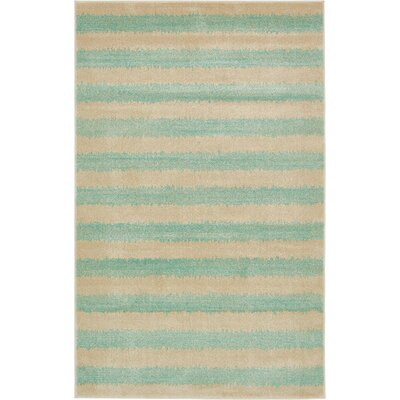 Travis Green/Beige Area Rug Rug Size: 5 x 8