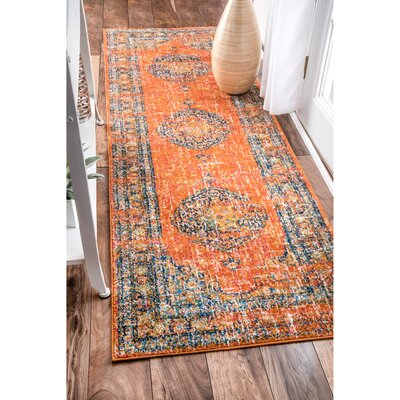 Pierce Orange Area Rug