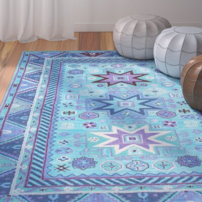 Ayon Hand-Tufted Blue Area Rug Rug Size: 76 x 96