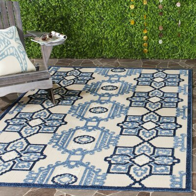 Reynolds Ivory/Blue Area Rug Rug Size: Rectangle 67 x 96