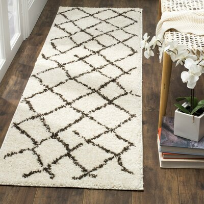Zettie Creme/Brown Area Rug Rug Size: 51 x 76