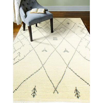 Floressa Hand-Knotted Ivory Area Rug Rug Size: 76 x 96