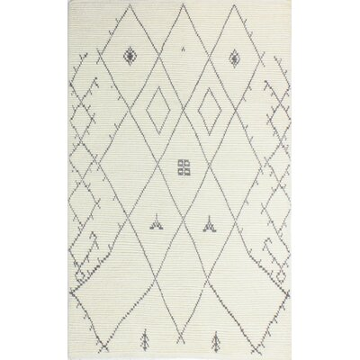 Floressa Hand-Knotted Ivory Area Rug Rug Size: 86 x 116
