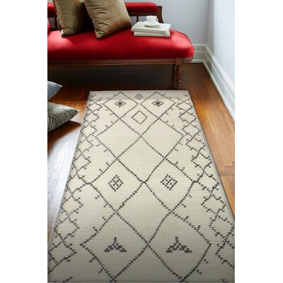 Floressa Hand-Knotted Ivory Area Rug Rug Size: 36 x 56