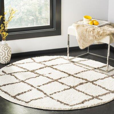 Zettie Creme/Brown Area Rug Rug Size: Round 51 x 51