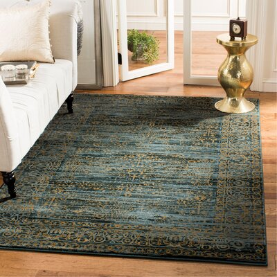 Zennia Turquoise & Gold Area Rug Rug Size: Rectangle 51 x 76