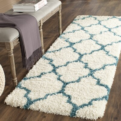 Kids Off-White And Teal Shag Area Rug Rug Size: Runner 23 x 7