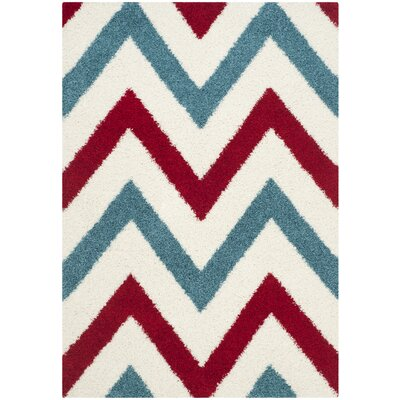 Kids Ivory & Red Shag Area Rug Rug Size: 53 x 76