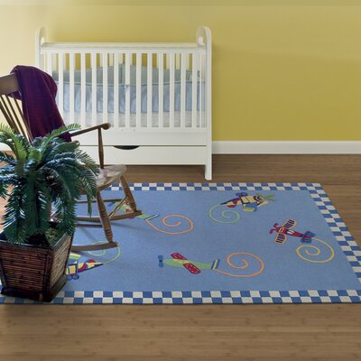 Shari Flying Fun Blue Area Rug Rug Size: Rectangle 76 x 96