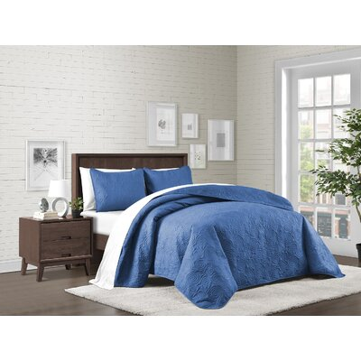 Kate Solid Swirl Design Reversible Quilt Set Size: King, Color: Blue
