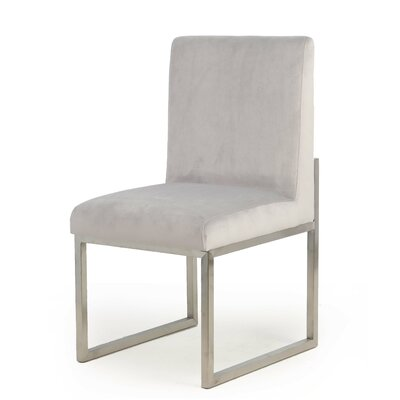 Caja Upholstered Dining Chair Upholstery Color: Silver