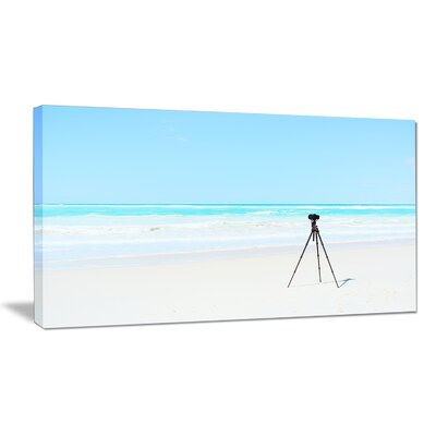 "Digital Camera and Tripod on Beach Photographic Print on Wrapped Canvas Size: 20"" H x 40"" W x 1"" D PT11403-40-20"