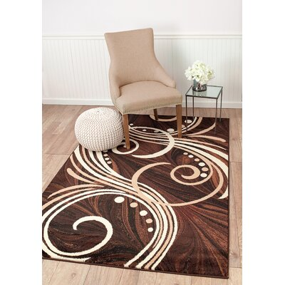 Frieda Brown Area Rug Rug Size: 74 x 106