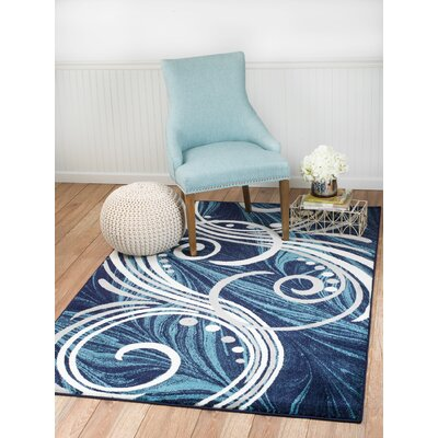 Frieda Blue Area Rug Rug Size: 74 x 106