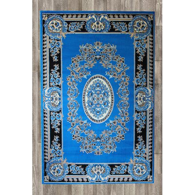 Chateau Blue Area Rug Rug Size: 74 x 106