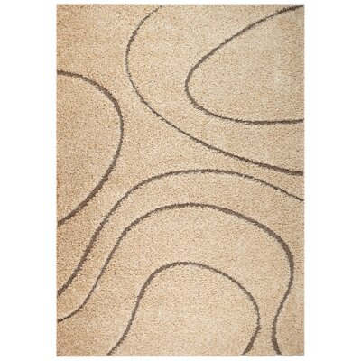 Quaoar Power Loom Beige Area Rug Rug Size: 5 x 7