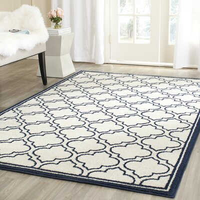 McArthur Traditional Ivory/Navy Indoor/Outdoor Area Rug Rug Size: Rectangle 26 x 4