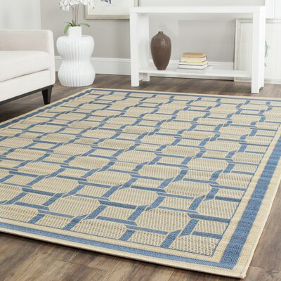 Resort Cream / Chocolate Area Rug Rug Size: 67 x 96