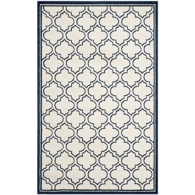McArthur Traditional Ivory/Navy Indoor/Outdoor Area Rug Rug Size: 6 x 9
