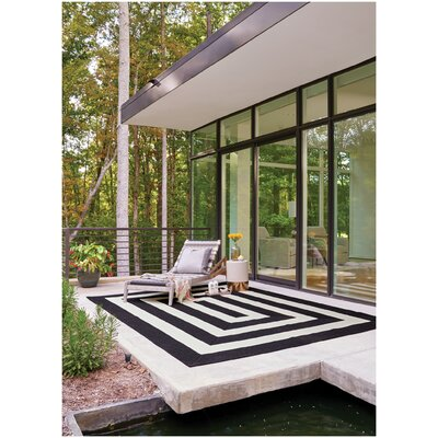Mitscher Black/White Striped Outdoor Area Rug Rug Size: Concentric 18 x 26