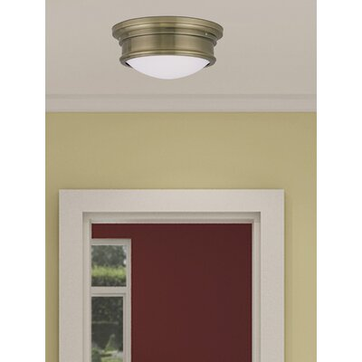 Alani 2-Light Flush Mount Size: 4.5 H x 11 W, Color: Antique Brass