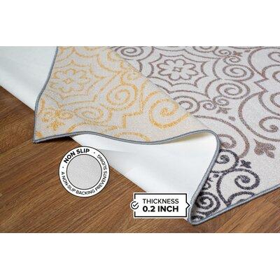 Tamarack Floral Swirl Cream Area Rug Rug Size: 17 x 25
